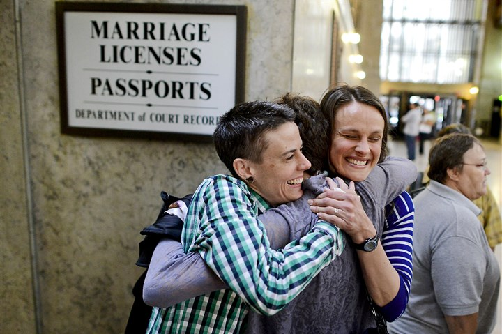 First same-sex marriage license applicants in Allegheny County The day after a federal judge ruled Pennsylvania's same-sex marriage ban unconstitutional, Jess Garrity, left, and Pamela VanHaitsma, right, hug their friend Jamie Phillips while standing first in line to apply for a marriage license Wednesday inside the City-County Building, Downtown.