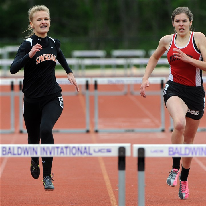 20140518ppWpialTrack9SPORTS Springdale senior Emily Lelis, left, won the WPIAL Class AA title in the 100-meter hurdles for the fourth time in her career.
