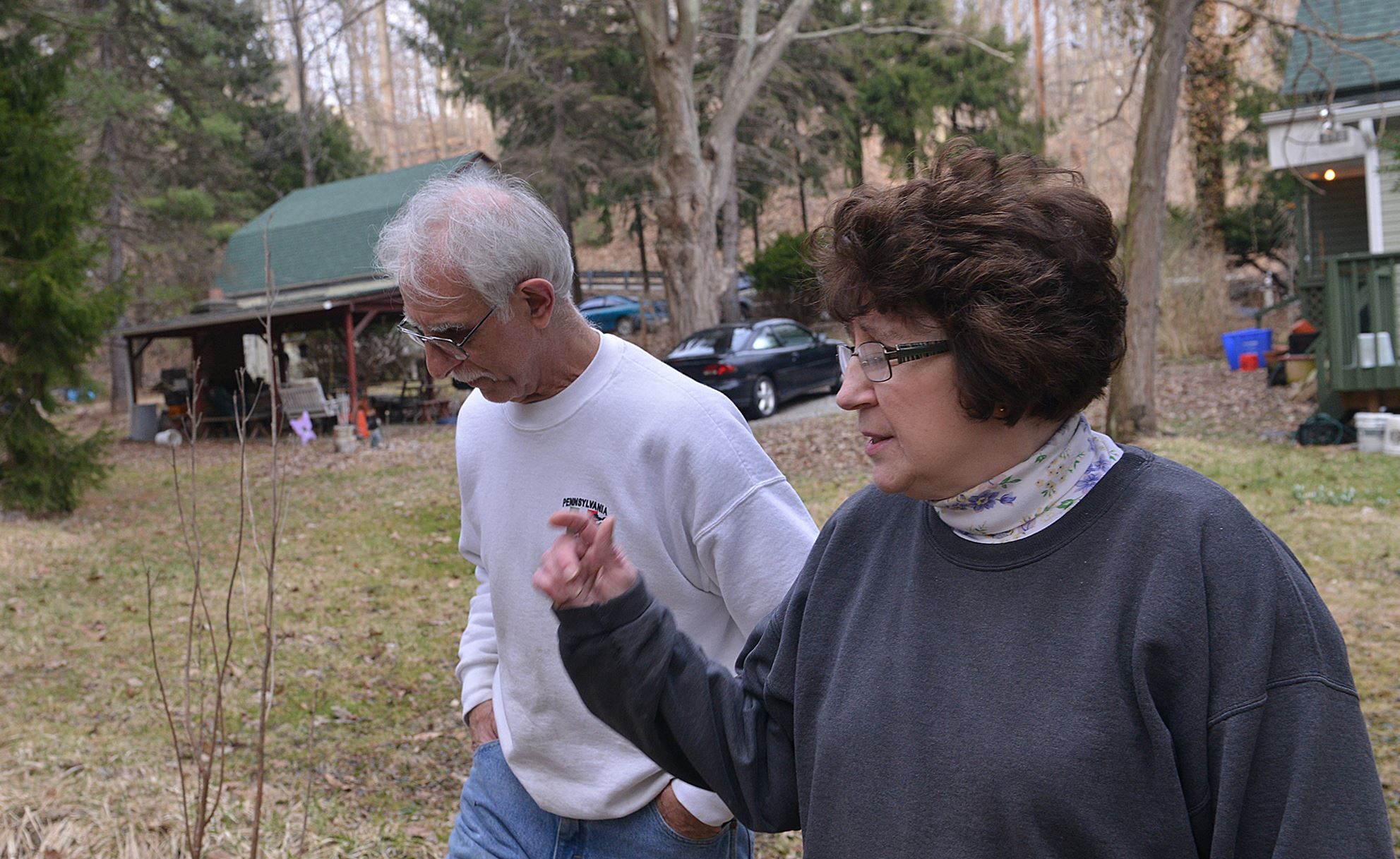 "Dearheart home husband Carol Pascuzzi, aka ""Dearheart,"" walks across her Turtle Creek property with her husband, Nick."