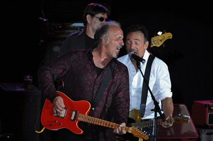"20140522bwJoeMag01 Joe Grushecky, left, and the Houserockers, are joined by Bruce Springsteen in ""Never Be Enough Time,"" written by Grushecky, as they perform at Soldiers & Sailors Memorial Hall & Museum in Oakland."