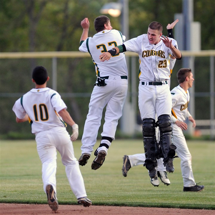 20140522SportsHSBB05-3 Blackhawk's Brendan McKay, left center, and Jake Emge, right center, celebrate their 15-0 win in four innings against West Mifflin in the AAA semi-final game at North Allegheny High School.