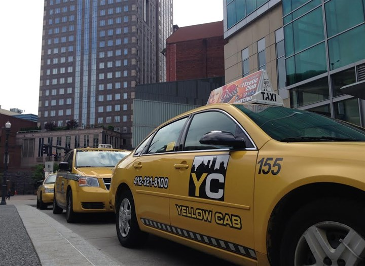 Yellow Cab taxis Yellow Cab taxis parked on Market Street in Downtown Pittsburgh on Thursday.