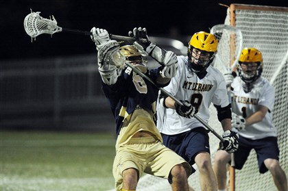 20140523bwLebanonSpts03 Shady Side Academy's Michael Concordia, left, protects the ball against Mt. Lebanon's Tim Donoghue in the WPIAL Division 1 boys lacrosse championship Friday at Highmark Stadium.