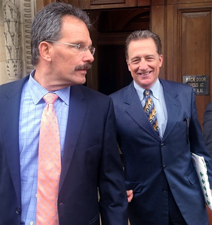 20140521LocHOPozonsky Paul Pozonsky, right, a former Washington County Common Pleas judge, leaves the Washington County Courthouse with his attorney, Robert Del Greco, following a pretrial hearing in May.