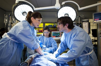 "0527NightShift2 Jeananne Goosen stars as Krista, Eoin Macken is Dr. T.C. Callahan in NBC's ""Night Shift."""