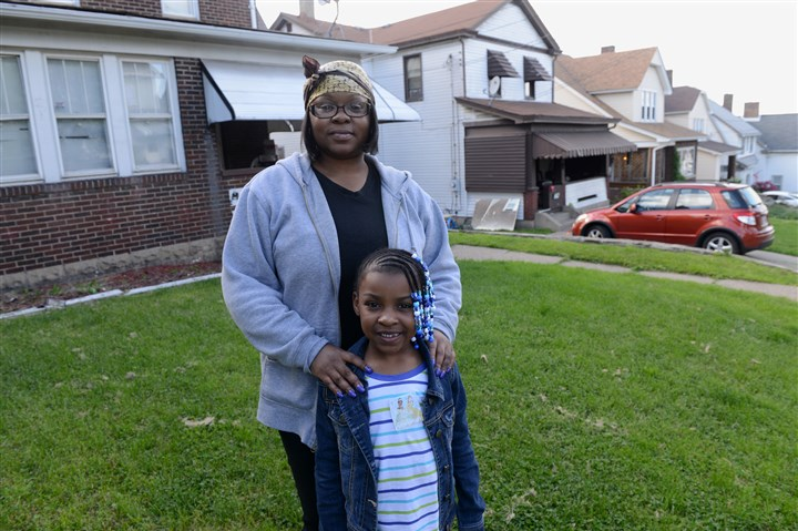 Aishia Shavers and her daughter Cameran Butler Aishia Shavers and her daughter Cameran Butler, 6, stand outside their McKeesport home.