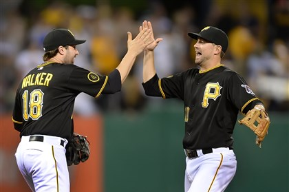 Neil Walker and Jordy Mercer Neil Walker and Jordy Mercer celebrate the Pirates' 3-2 win over the Nationals Saturday night at PNC Park.