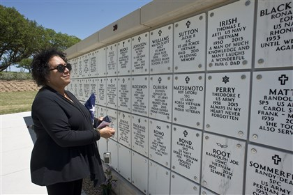 Anita Berlanga at Central Texas State Veterans Cemetery Anita Berlanga looks at a mausoleum wall at the Central Texas State Veterans Cemetery near Fort Hood following the formal military funeral for her father, Johnny Holmes, 91, a World War II Army veteran of the Army who died in March 2013. Ms. Berlanga paused to look over those sharing her father's final resting place, an area called the Columbaria, where cremated remains are interred.