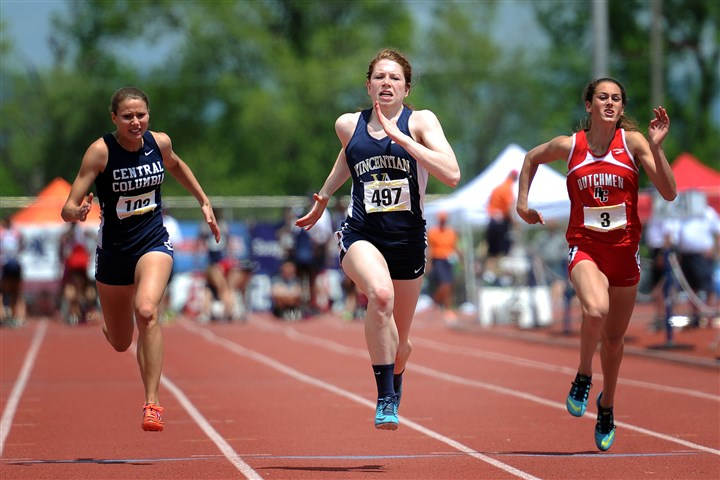20140524jrTrackSports9-20 Ally Bartoszewicz (center) competes in the AA girls 100-meter dash Saturday in the PIAA track and field championships at Shippensburg University in Shippensburg, Pa.
