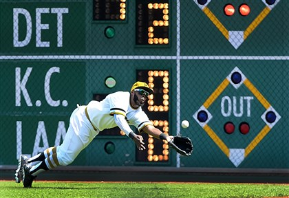 201405025pdPiratesSports03-2 Pirates right fielder Josh Harrison makes a diving catch but then loses the ball on a hit by the Nationals' Ian Desmond, who after review was awarded a hit on the play, May 24 at PNC Park.