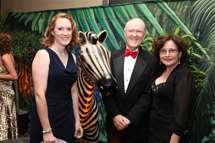MVHGalaPeppers5-14 (2) Dr. M. Elizabeth Pepper, with her parents, Dr. L. Douglas Pepper and Mrs. Maria Pepper, mingle in the jungle before dinner at Monongahela Valley Hospital's 26th Annual Gala.