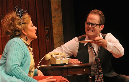 "20140525lrnoisesoffmag06-4 Helena Ruoti, left, as Mrs. Clackett, and Noah Plomgren as Gary try to make sense out of a plate of sardines in ""Noises Off."""