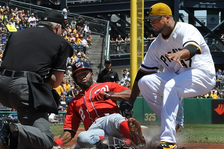 liriano0526a Washington's Denard Span scores past the late tag of Pirates starter Francisco Liriano after a wild pitch Sunday in the first inning.