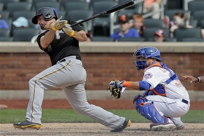 Pirates Mets Baseball Pittsburgh Pirates first baseman Gaby Sanchez (17) follows through on a base hit that scored Neil Walker and Andrew McCutchen during the ninth inning of a baseball game, Monday, May 26, 2014, in New York. The Pirates won 5-3. (AP Photo/Julie Jacobson)