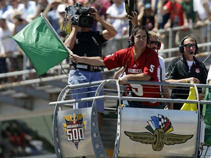 IndyCar Indy 500 Auto Racing Dallas Mavericks owner and Mt. Lebanon native Mark Cuban waves the green flag to start the 98th Indianapolis 500 IndyCar race at the Indianapolis Motor Speedway Sunday.