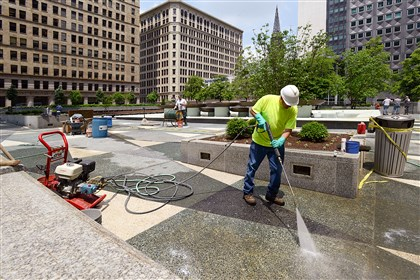 20140522radMellonSquareLoca.3-1 The restored terrazzo is acid washed at Mellon Square in Downtown.