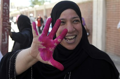 530146609 A supporter of ex-army chief Abdel-Fattah el-Sissi celebrates after voting in front of a polling station in the Mediterranean port city of Alexandria on Monday.