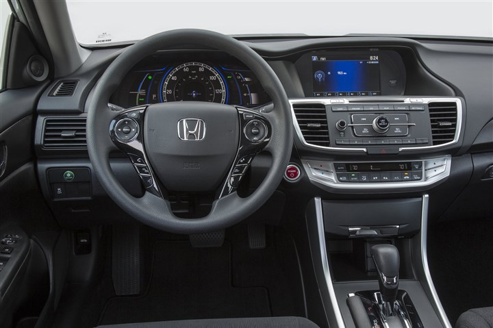 20145025AccordInterior Interior: The gauges and dashboard of the 2014 Honda Accord Hybrid are more conventional than the Prius, and quite handsome as well.