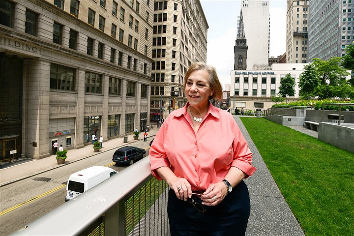 20140522radMellonSquareLoca.1 Susan Rademacher of the Pittsburgh Parks Conservancy on the terrace overlooking Smithfield Street at the restored Mellon Square in Downtown. Reopening ceremonies will be this week.