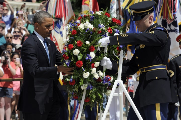 Obama Memorial Day President Barack Obama lays a wreath at the Tomb of the Unknowns at Arlington National Cemetery in Arlington, Va., as part of Memorial Day ceremonies.