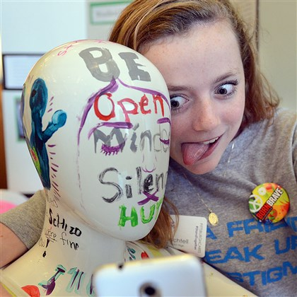 20140527radStandTogetherLocal02-1 Claire Bachtell of Woodland Hills Jr. High School makes a face as she takes a selfie with a mannequin in her school's Stand Together project that invites people to take selfies as a way to deal with stigmas.
