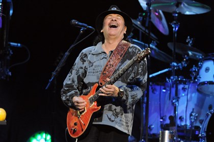 "20140527bwSantanaMag01 Carlos Santana sings ""Da le Yaleo"" with his band Santana."