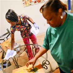 20140523MWHseniorsBiz01 Michelle Cammon, left, a Community Human Service In-Home Specialist, helps 59-year-old Ruth Russell with household tasks, like cleaning tables and taking out garbage, during her weekly visit on May 23.