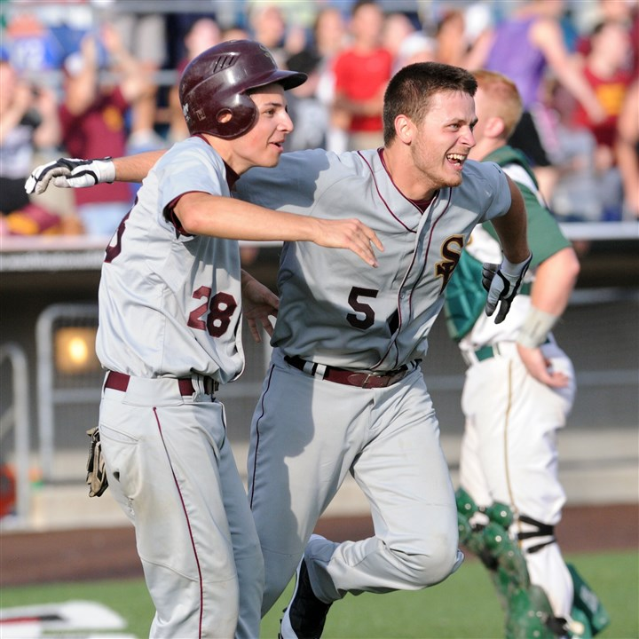 20140527JHSportsBB08-5 Steel Valley's Sam Ligeros, left, and Michael Hoesch score the go ahead runs against Seton-LaSalle in the 7th inning and win their first ever WPIAL baseball championship.