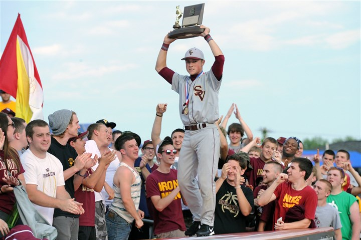 20140527JHSportsBB01 Steel Valley's Andrew Chuba parades the WPIAL Championship trophy along the dug out roof in front of their fans as Steel Valley defeats Seton-LaSalle 6-5 and wins their first ever baseball championship.