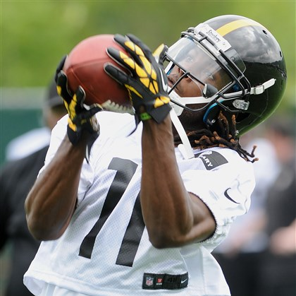 wheaton0618 Steelers wide receiver Markus Wheaton pulls in a pass at an OTA practice at their South Side training facility last month.