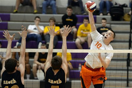 20140520mfvolleysports05.jpg Bethel Park's Jacob Dixon goes for a kill shot against North Allegheny's Robert Stiefvater and Jeremy Best during a WPIAL Class AAA semifinal match last week at Baldwin.