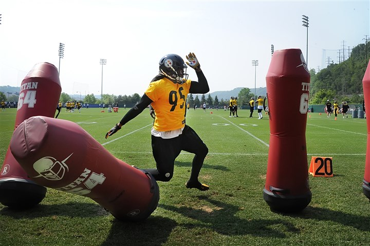 20140527pdSteelersSports01 Linebacker Jarvis Jones makes his way through the tackling dummies as the Steelers begin OTA sessions Tuesday morning on the South Side.