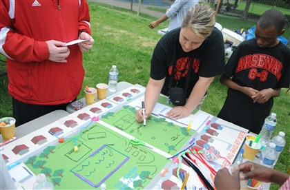 20140529DARarsenalparkLocal.2.jpg Life Skills Support teacher Marnie O'Connor draws ideas from her middle school students including Tyshawn Daniels, 11, onto a map of Arsenal Park in Lawrenceville. Students were tasked with thinking up ideas for improvements to the park.