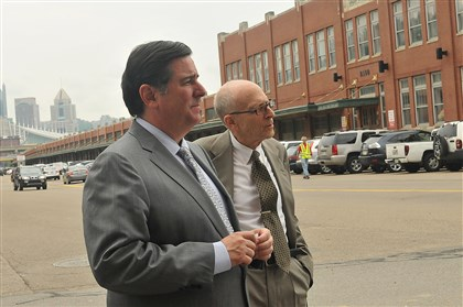 20140529lrstriplocal05-4 Pittsburgh Mayor Bill Peduto stands with Arthur Ziegler, president of the Pittsburgh History & Landmarks Foundation, in front of St. Stanislaus Church before a press conference announcing the listing of the Strip District on the National Register of Historic Places.