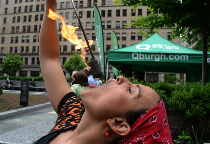 20140529dsMellonSqLocal09-1 Kristin Ward performs fire eating at the reopening of Mellon Square.