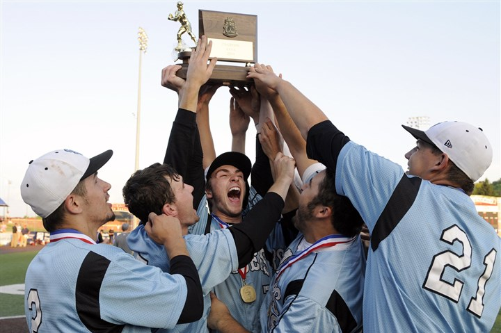 20140529mfsenecasports02-13 Seneca Valley teammates hoist their trophy after defeating Baldwin in the WPIAL Class AAAA championship Thursday.