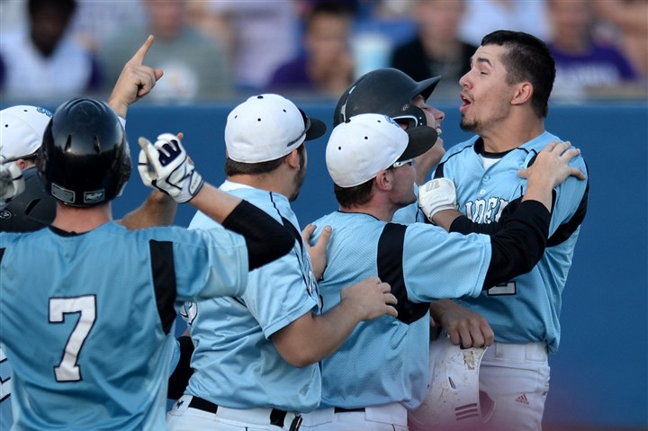 20140529mfsenecasports03-14 Seneca Valley's Matthew Rafferty is congratulated by teammates after hitting a home run against Baldwin in the WPIAL Class AAAA championship Thursday.