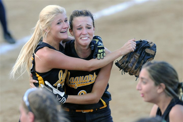 20140529JHSportsGirls04-4 Thomas Jefferson's Becca Bachman, left, and Janelle Allison celebrate after winning the WPIAL AAA softball championship Thursday, beating Mars, 5-3, in nine innings at Lilley Field in California, Pa.
