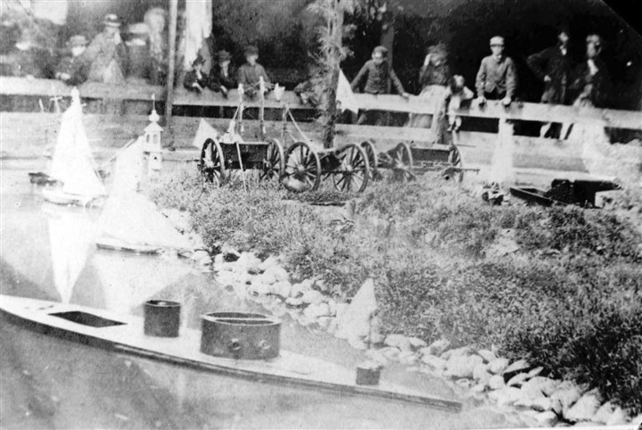 20140529sanitary0601-3 A working model of the Monitor ironclad warship makes its way around a pond during the Sanitary Fair.