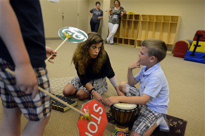 "20140529bwMusicPghPress01 Kathleen ""Katie"" Harrill of Bridgeville works with Brady Wiggers, 7, of South Fayette. Ms. Harrill has been nominated for a Grammy Music Educator Award by the Grammy Foundation. She works with behaviorally and emotionally challenged students at Wesley Spectrum in Bridgeville."