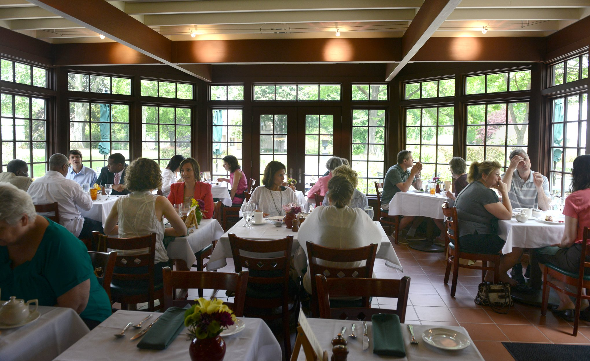 The Cafe at the Frick window view Windows in the dining room at The Cafe at the Frick give diners a view of the gardens and the Frick mansion, Clayton.