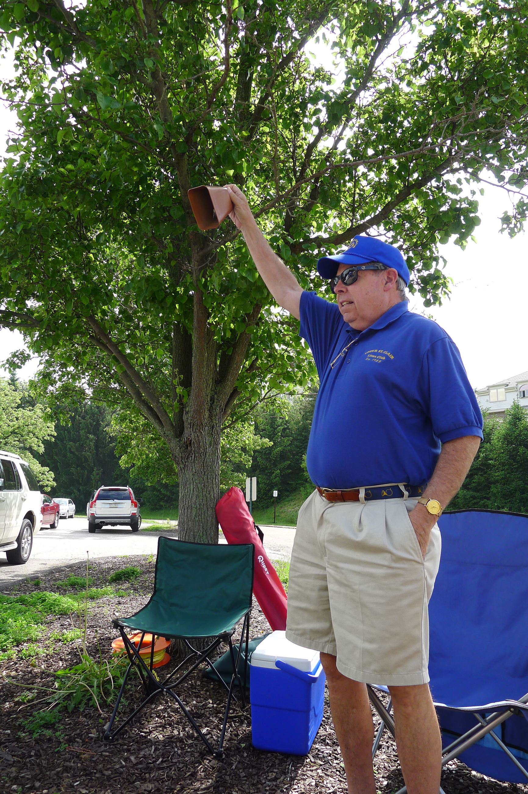 P1230812-13 Lions Club volunteer Rick Cobb rang the cowbell right at 4 p.m., signifying that customers could start buying at opening day at the Upper St. Clair Farmers Market on May 29.
