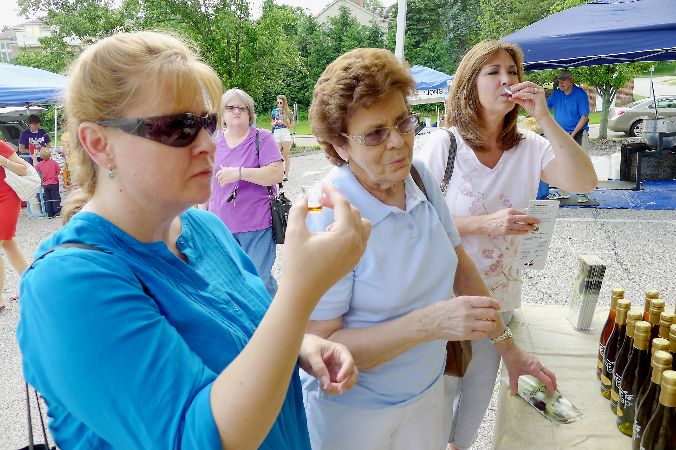 P1230847-15 Geralyn Seng, Harriet Seng and Tracy Wilson had an olive-oil tasting at the Olive Tap booth at the opening day at the Upper St. Clair Farmers Market.