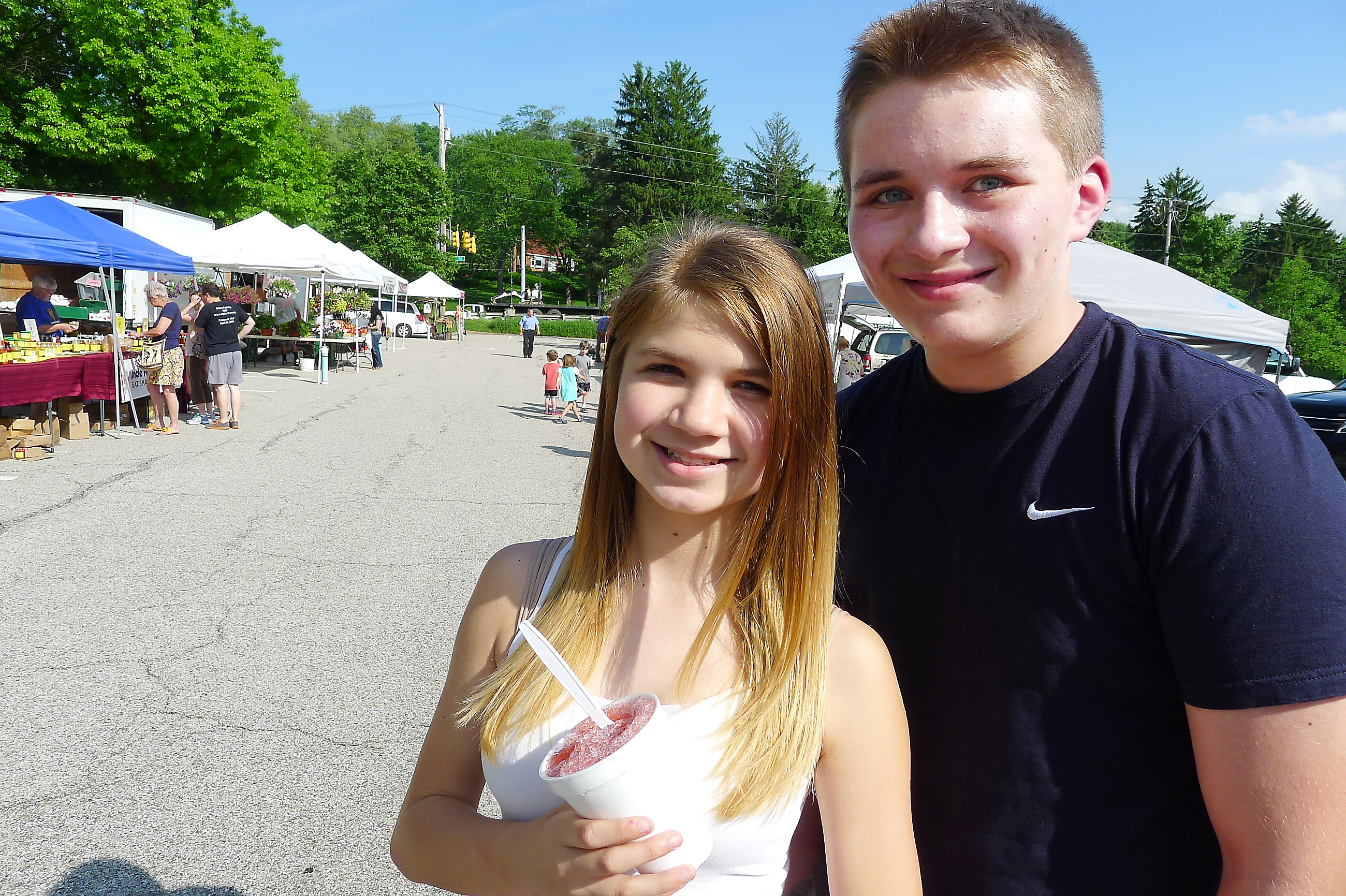 P1230876-20 Susan Mathie and Dominic Ivol strolled through with their pomegranate shaved ices at opening day at the Upper St. Clair Farmers Market on May 29.