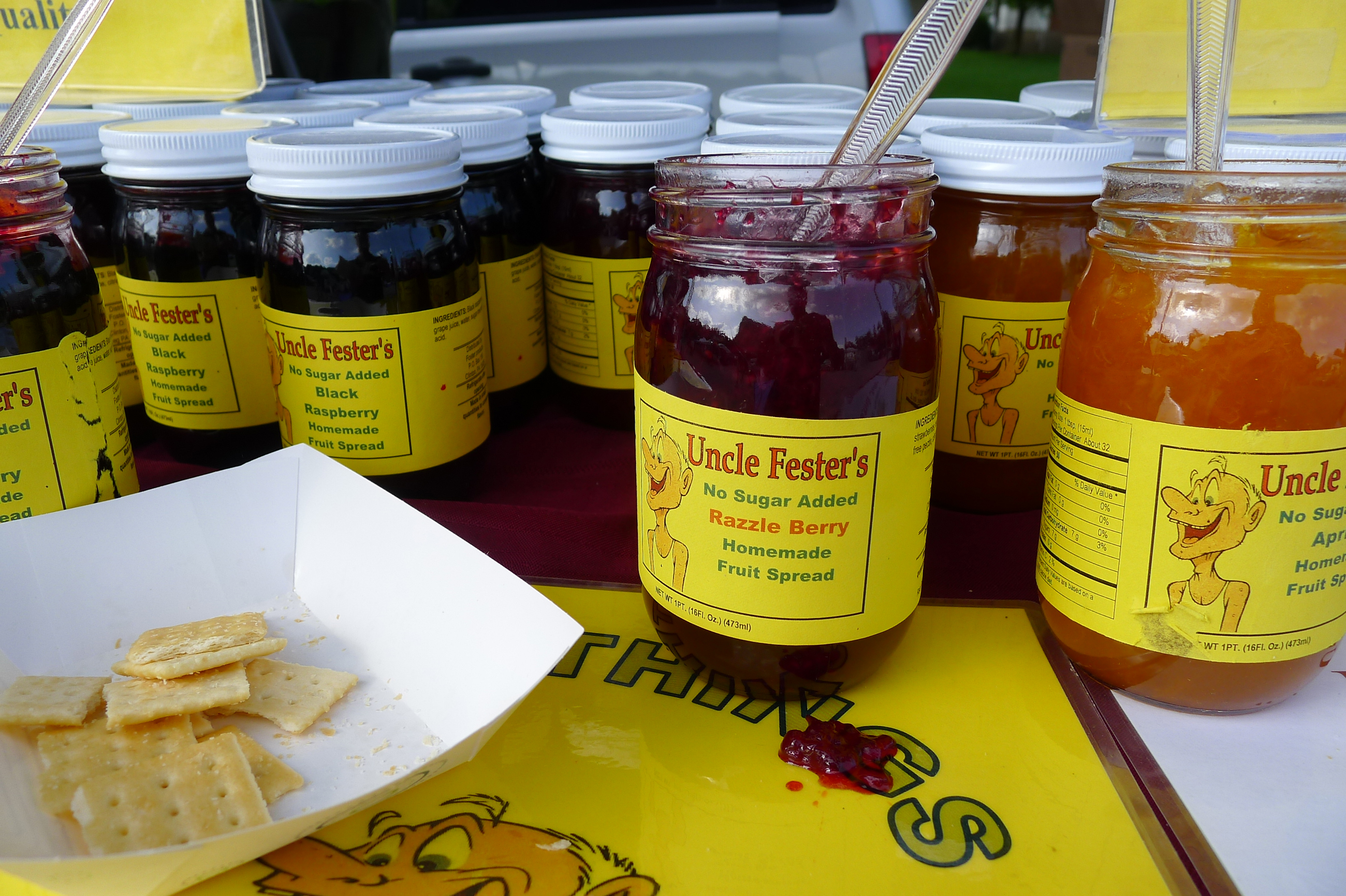 P1230882-22 At opening day at the Upper St. Clair Farmers Market on May 29, a big draw is the chance to sample products, such as Uncle Fester's jams and jellies.