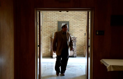 Samuel Bernstine, a member of Temple Hadar Israel Samuel Bernstine, a member of Temple Hadar Israel in New Castle, walks through the front entrance of the synagogue in April before a performance of a play about the Holocaust.