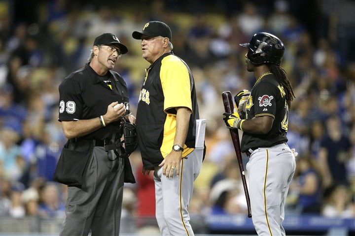 Manager Clint Hurdle, umpire Paul Nauert and Andrew McCutchen Manager Clint Hurdle, center, argues with home plate umpire Paul Nauert after Andrew McCutchen, right, struck out during the third inning Friday night in Los Angeles.