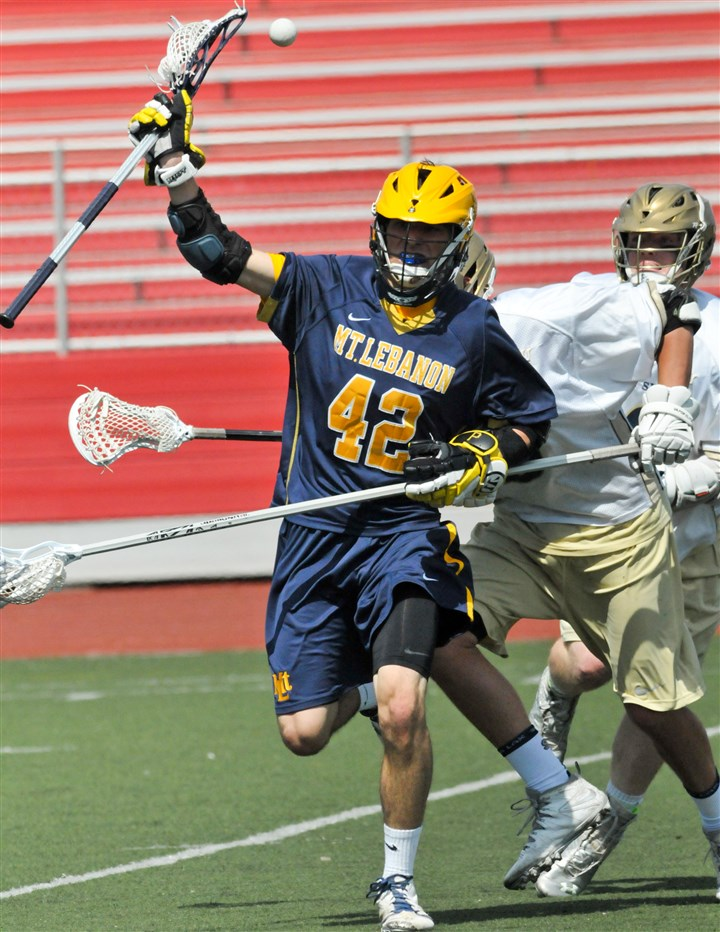 mtlebanonlacrosse0601 Mt. Lebanon's Brian Ward (No. 42) carries the ball in a PIAA lacrosse quarterfinal against Shady Side Academy, at Moon High School stadium, Saturday, May 31, 2014.