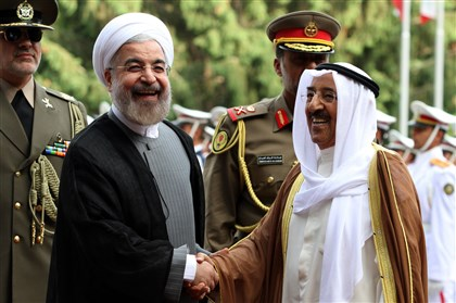 530301957 Iranian President Hassan Rouhani, left, greets Emir of Kuwait Sheikh Sabah al-Ahmad al-Sabah upon his arrival in Tehran on Sunday.