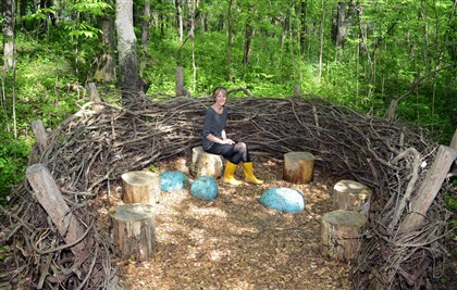 20140522GardenMag01 Kitty Vagley sits in a giant bird nest at the Pittsburgh Botanic Garden.
